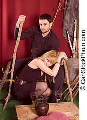 Enamorued couple posing in studio retro enterior-focus on...