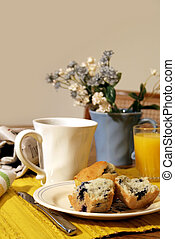 Breakfast Table - Breakfast table with blueberry muffins,...