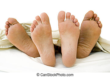 Parents feet with their new born Child - The feet of a young...