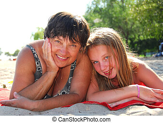 Family beach - Portrait of grandmother and granddaughter...
