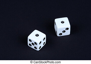 Snake Eyes - Two dice both rolled to one on a black...