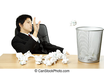 Stressed businessman - A businessman throwing trash paper...