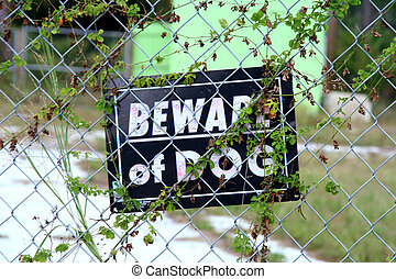 Beware of Dog - Beware of dog sign on fence