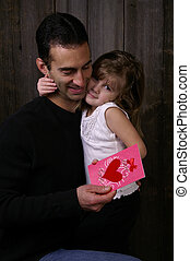 Fathers love - A young girl giving her daddy a valentine