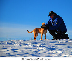 best friend puppy - man holding his dog in a winter scene