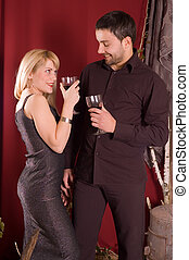 Drinking wine - Couple drinking red wine at retro enterior...