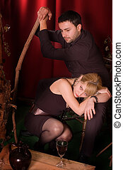 Enamorued couple posing in studio retro enterior