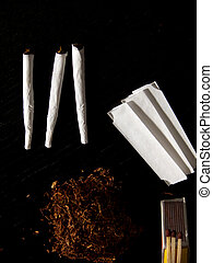 joints - Portrait of handrolled joints on black