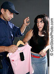 Shoplifting is a crime. A security guard dangles handcuffs...
