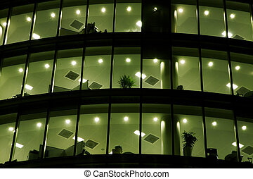 building - Shot of a corporate office building in the night.