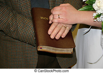 Foundation - a husband and wife with their hands on a Bible