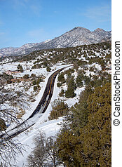 Snowy Road - Colorado mountain road partly covered with snow...