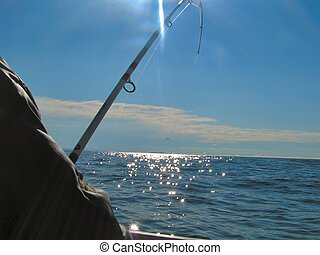 Deep sea fishing - a man is deep sea fishing for cod off of...