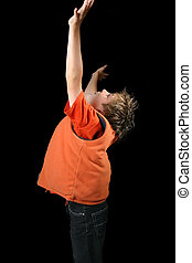 Worship and Praise - A child lifts his hands in praise