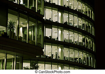 building - Shot of a corporate office building in the night