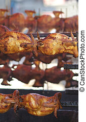 Chicken barbeque - Several chickens being barbequed on large...