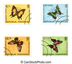 Colorful butterflies on post stamps
