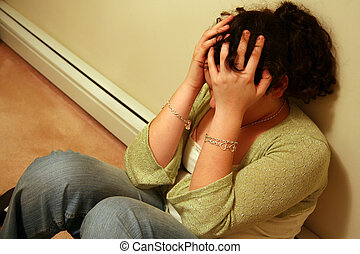 Teenager with Depression - Young Teen holding Head with a...