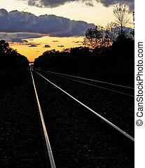 Tracks at Sunset#3 - Railway tracks leading off into the...