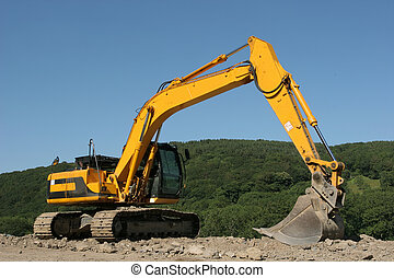 Track Machine - Yellow digger standing idle on a building...