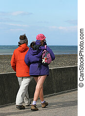 Healthy Twosome - Warmly dressed couple out for a walk along...