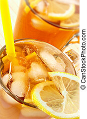 Cold tea with cubes of an ice and a lemon-is fine satisfies...
