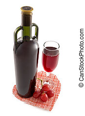 Bottle and glass of red wine on a background of...