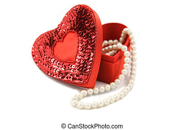 Valentine Box and Pearls on White - A satin heart shaped box...