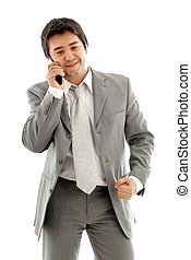 friendly chat - businessman with cellular phone in grey suit...