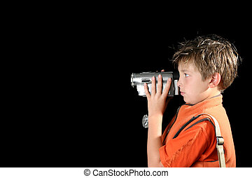 Home video camera - Boy filming using a home video camera,...