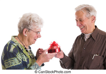Sharing a moment of fun - Cute elderly couple having fun...