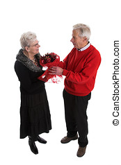 Valentines bouquet - Pretty elderly couple giving flowers...