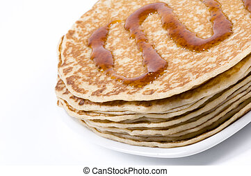 pancakes with syrup - a stack of pancakes with syrup