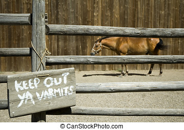 Horse corral - Horse in a corral with a \\\'keep out ya...