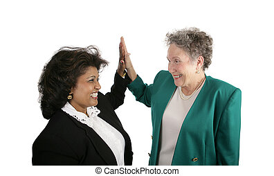 Business - High Five - A diverse female business team giving...