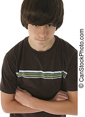 Thirteen - Cute 13 year old boy with arms crossed. White...
