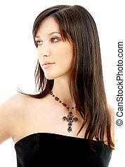 lovely brunette with crucifix - portrait of lovely brunette...
