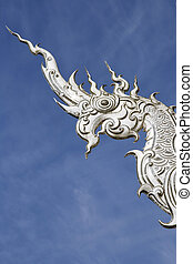 Bird in the sky - Architectural detail of Wat Rong Khun...