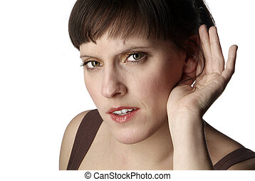 listening woman - a young woman is holding one hand to her...