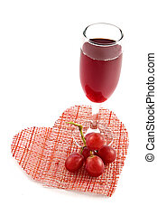 Glass of red wine on a background of heart-romantic...