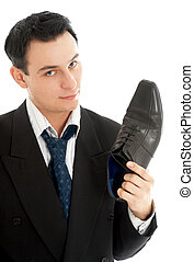 salesman with black leather boot - picture of salesman with...
