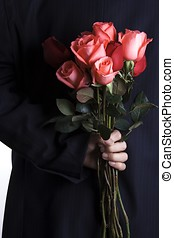 Proposing - A man with business suite holding roses...