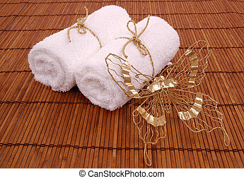 Towels and butterfly on bamboo