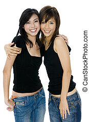 Young Asian Women - Two young asian women in jeans and black...