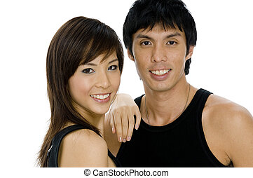 Young Adults - Two good-looking young asian adults in black...