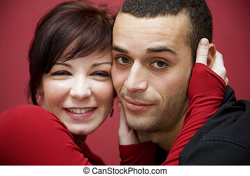 valentines day - portrait of a young couple kissing each...