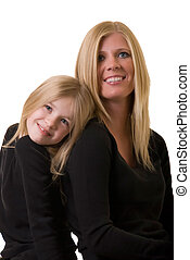 mother and daughter - faces of attractive mother and eight...