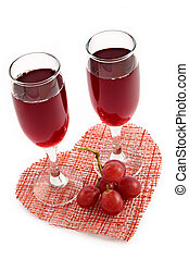 Red wine and grape on a background of heart-romantic...