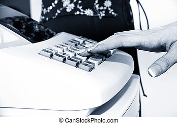 Cash Register - Woman\\\'s hand on cash register buttons....