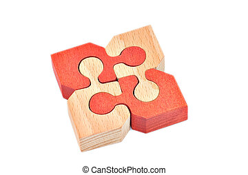 Puzzle - Wooden puzzle of four pieces, isolated over white